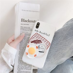 white and yellow egg phone case
