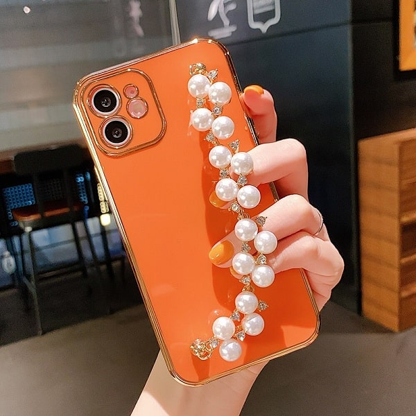 Orange gold plated phone case with chain strap